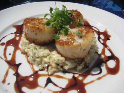 Sautèed Day Boat Sea Scallops with Hudson Valley foie gras risotto and a drizzle of star anise infused pomegranate reduction