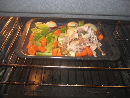 Roasting the veggies and the chicken bones.