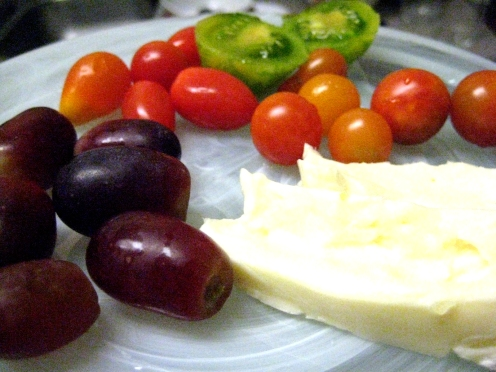 Meaty heirloom tomatoes, rich brie cheese, and sweet grapes!